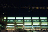 A night time view of the San Diego Convention Center with Coronado Island in the background stock photo #3014