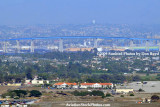 The Navy Lodge at NAS North Island in the foreground and the Coronado Bridge in the background landscape stock photo #4765
