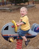 July 2007 - Kyler having fun on United Airlines springy airplane at Palmer Park