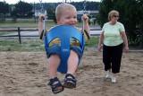 July 2007 - Kyler on the swings at Palmer Park