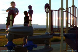 August 2010 - Kyler and another young lad on the playground at Peterson AFB at sunset
