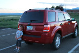 August 2010 - Kyler and our rental vehicle after spotting airplanes for me to photograph