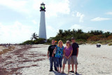 November - Jonathan Perez, Donna, Lisa Marie Criswell Law and Creed Law in front of the Cape Florida lighthouse