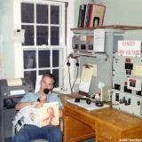 1967 - Don standing radio, telephone and teletype watch at Coast Guard Station Lake Worth Inlet, Peanut Island
