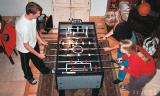 2003 - Champion Snowboard Justin Reiter, Brenda Reiter and Karen D. Boyd playing Foosball
