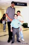 1999 - Tallest NBA player Gheorge Muresan, Dave Kaufman and Kev Cook at JFK