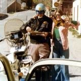 1975 - Brenda hamming it up with the trooper - she still got the speeding ticket