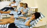 (Forgotten name), YN2 Karen Sherfick, YN1 Karen Fraser and YN2 Kay Gonzalez sunbathing at lunch time at CGRU Miami IV (07-83479)