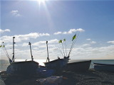 SILHOUETTED FISHING BOATS
