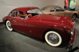 Aluminum bodied 1947 Cisitalia 202 Coupe by Pinin Farina, from Petersen Collection, with cheaper fiberglass copy in background