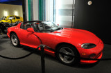 1992 Dodge Viper ... body primarily fiberglass like Corvette's because low volume didn't justify costly tooling for metal body
