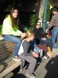 waiting for shuttle to Disneyland, Em works on Keefer's ponytail