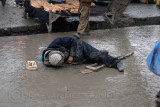 Man dying on the street...