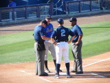 Charlotte Manager Jim Morrison exchanges lineups with St. Lucie Manager Tim Teufel