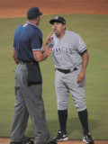 Luis Sojo argues the call by home plate umpire Travis Carlson