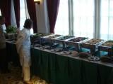 Grandmother Inspecting Sundanese Buffet.jpg