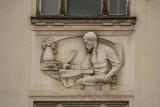 Building Detail - Man Writing
