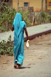 Woman in Sky-Blue Sari Walking Away