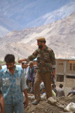 Armed Soldier Controlling Crowd Leh