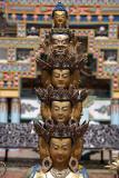 Statue in front of 1000 Buddha Stupa Detail Kopan Monastery 02
