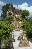 Statues in front of 1000 Buddha Stupa Detail Kopan Monastery