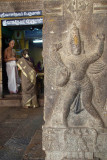 Figure on Pillar Shrine in background Sri Ranganathaswamy Temple
