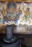 Stone Lingam with Painted Wall behind