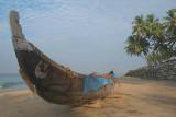 Boat and Palms on Black Beach Varkala