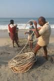 Fishermen Pulling in Nets Black Beach
