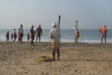 Fishermen Pulling in Nets Black Beach 03