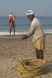 Fishermen Pulling in Nets Black Beach 02