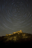 Star trails over fort ruins