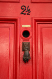 Hand Knocker on Red Door