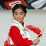 Chinese girl performing a mongolian dance called the happy chop sticks