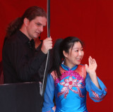 backstage scene...female chinese acrobat and her stage supporter