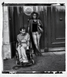A disabled spectator at the final of the Tour de France with his supporter