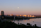 Sun setting as gibbous moon rises over Perth Water