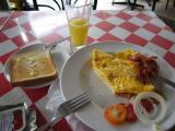 breakfast at the Lucky Beer & Guest House, 90 Baht for 2 egg omlet, bacon, toast and pineapple juice