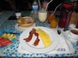 breakfast Sunday morning @ Tuptim's, Banana Milkshake 45B,2 egg omlet, bacon, OJ, toast butter jam and tea for 120b