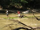 sin on bamboo raft going down river