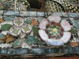 Using porcelain from China isn't as extravagant as it might sound. In the early days of Bangkok, Chinese trading ships calling on the Siamese capital used tons of porcelain as ballast. The temple is just an early example of the Thai approach to recycling.