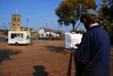 Artist painting ice cream van in Stalybridge