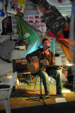 Chris Cyprus performing on stage at Woodend Mill