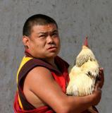 A monk and his chicken, Trongsa, Bhutan