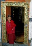 boy monk in doorway-Bhutan
