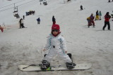 Mari fazendo snowboard