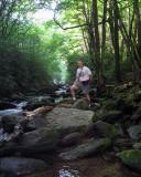 Rick on the rocks in the creek.jpg