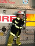 Firefighter Logan saluting