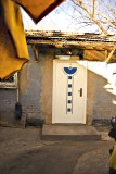 new door in a very old village_China