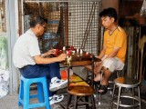 Men Playing Chess With a Self Made Board and Pieces